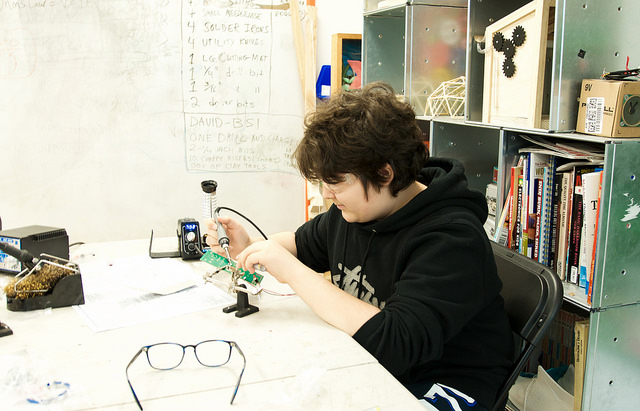 Jett soldering what would eventually be a mini-speaker.