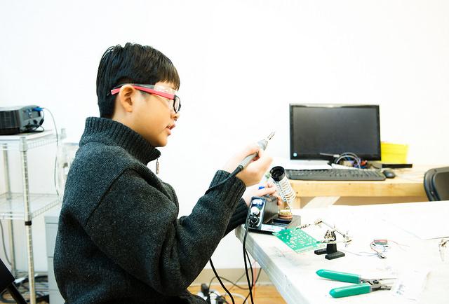 Chris soldering his circuit.