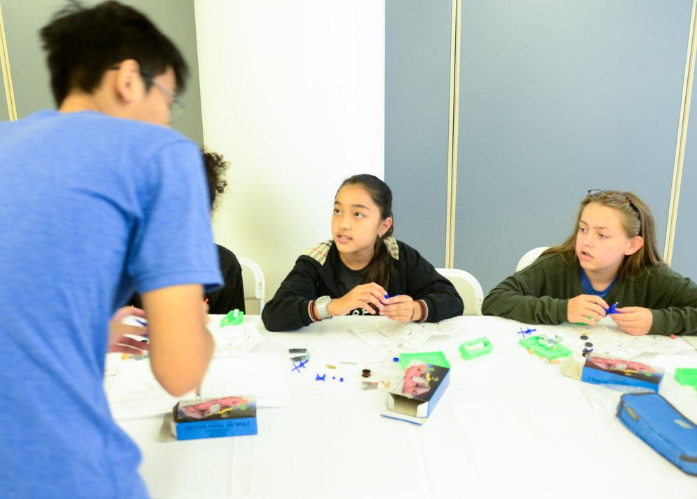 Mentor teaching students during program