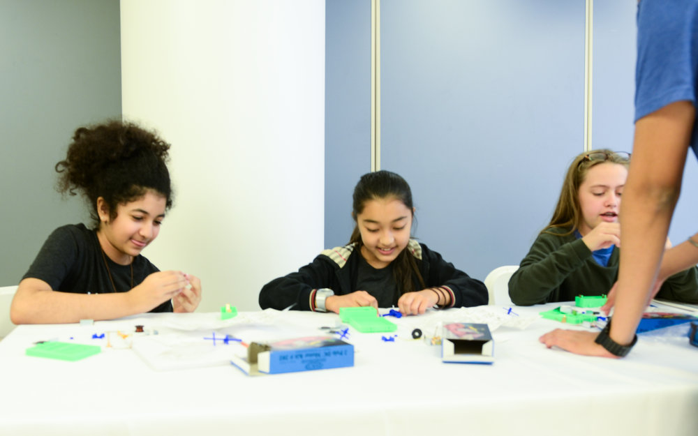 Students engineering together during program