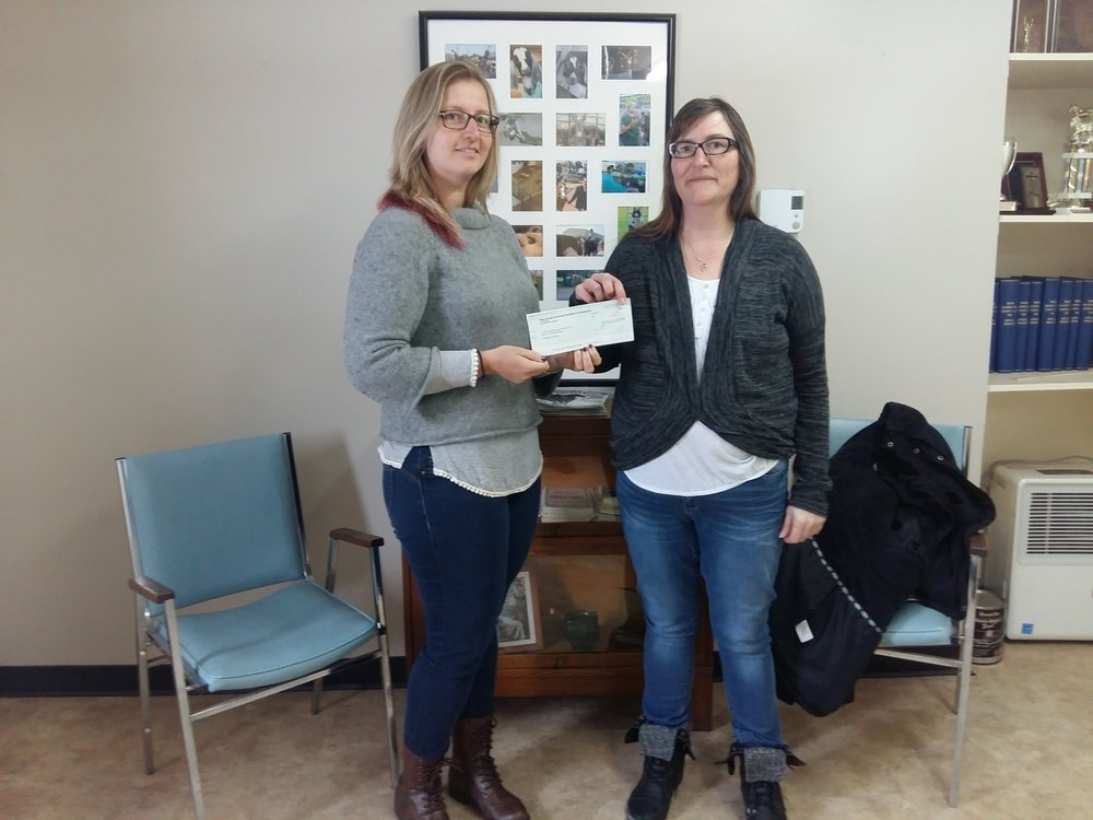 Proceeds of calendar sales presented to the Colchester Food Bank by the NSPEC Complex.