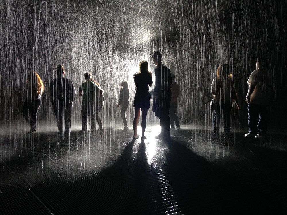 Keeping Dry In The Rain. An installation of the Rain Room at LACMA. Can you see the eye ?  Sensors in the celling followed you movements bellow and paused the rain only where you were walking., staying completely dry in the rain. AMazing.