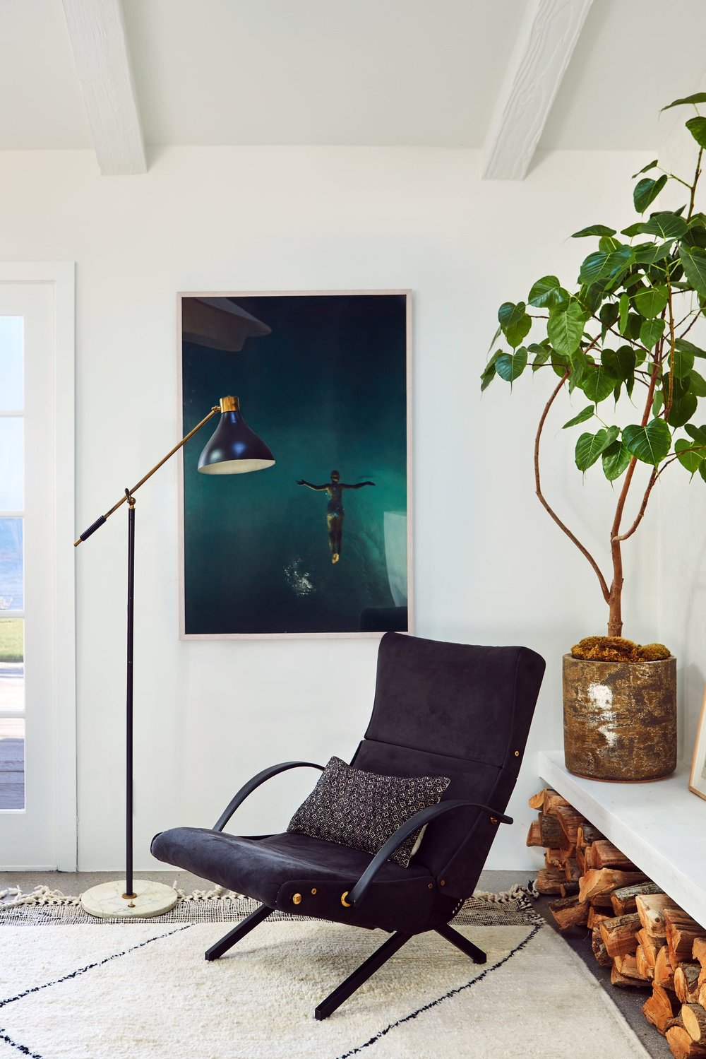 A vintage 1950s chair by Osvaldo Borsani serves as a sculptural element in a Malibu, Calif., living room by Alexander Design.CreditSam Frost
