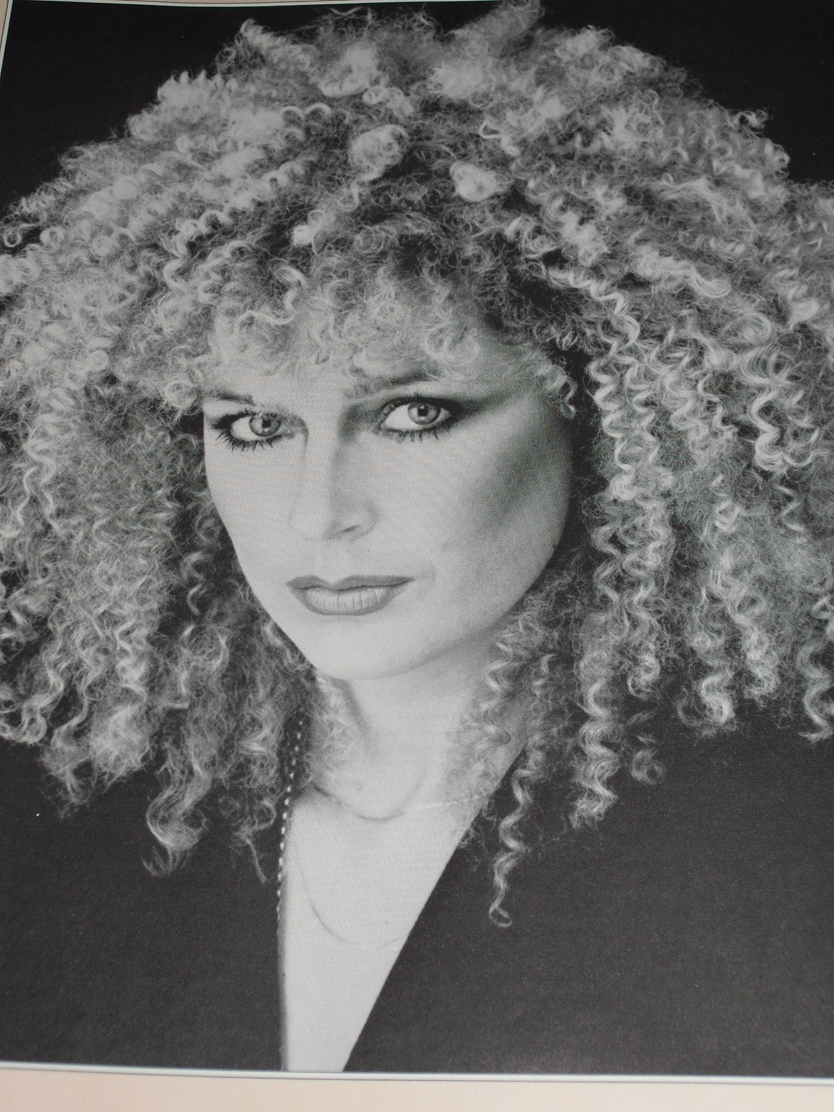 Woman with dramatic, curly hair