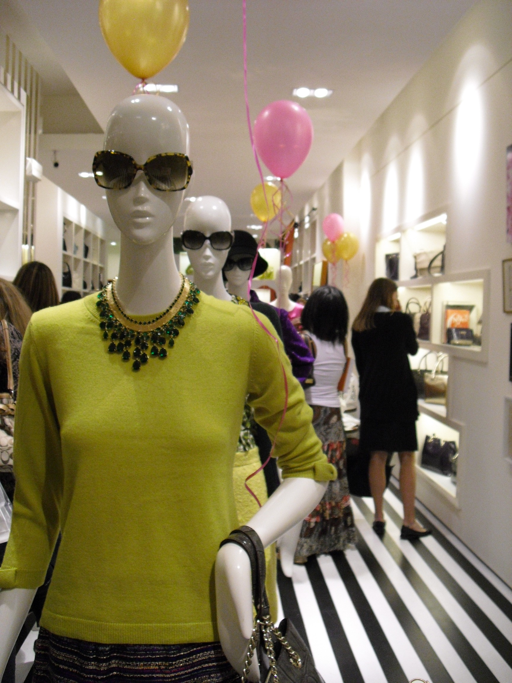 Sweaters and jewelry on mannequins - Kate Spade, Georgetown