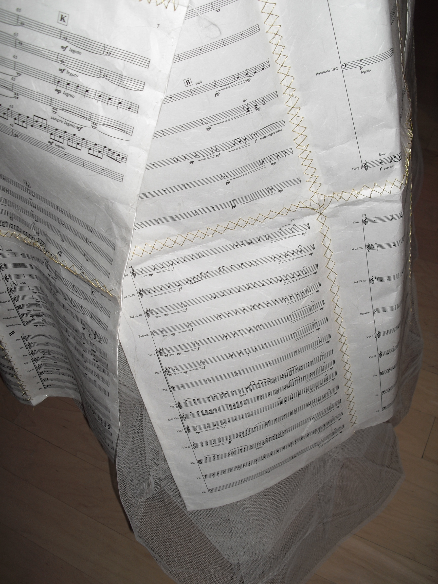 Close up of sheet music dress worn by Julie Feeney