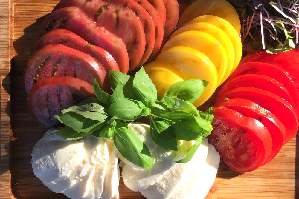 Ingredients:   4 medium Heirloom or other tomatoes (around 1.5 lbs)  ½ cup chopped Basil  ½ pound fresh Mozzarella or Bocconcini     Dressing   4 Tbsp olive oil  1 tsp Balsamic vinegar  ½ tsp Lemon juice  ½ tsp Chef Josef's Original or Chef Josef's Lemon Dill Seasoning blend    Slice tomatoes.    Mix oil, vinegar and seasoning blend for the dressing.  Place tomatoes and mozzarella on individual serving plates. Add dressing on top. Finish with sliced basil.     *Note: I find that when I make a salad dressing it is important to use a really good vinegar. A good balsamic vinegar can be pricey, but you will only need very little, so it is really worth every penny.You can make extra dressing and save it in the refrigerator for another salad.
