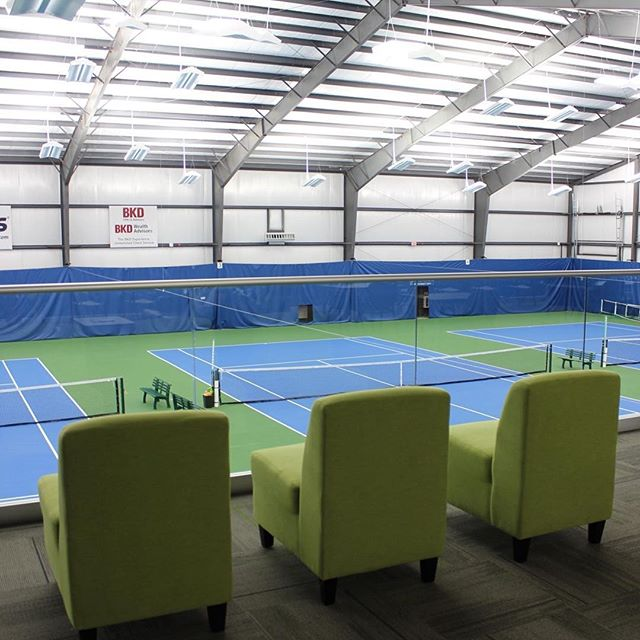 It's no big deal that the temperatures are dropping and it's raining for the residents of Boone County. They can enjoy tennis all year long in their brand new tennis center. There are even four more courts on the other side of this facility. We wouldn't mind watching from these cool green chairs either!