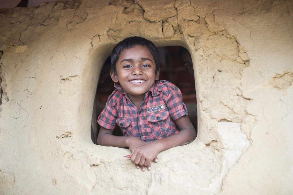 Rohingya Child through classroom 'window'