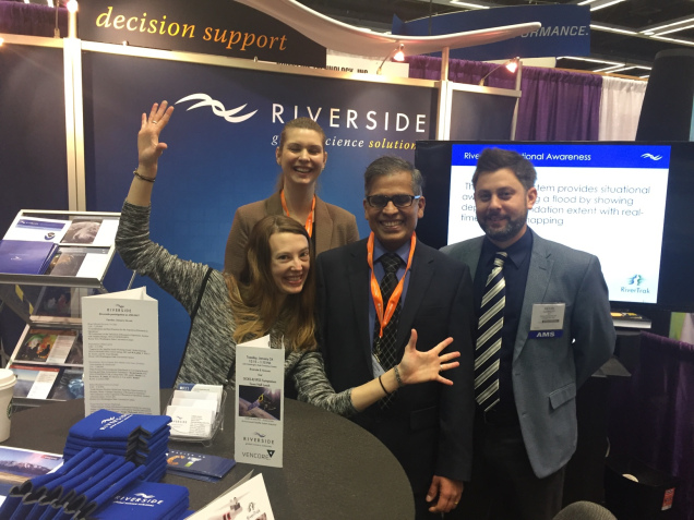 Riverside employees having fun at the booth