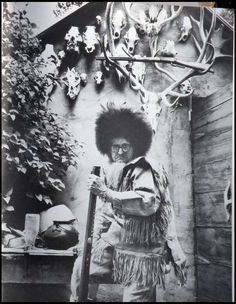 Buckskin in front of his cabin