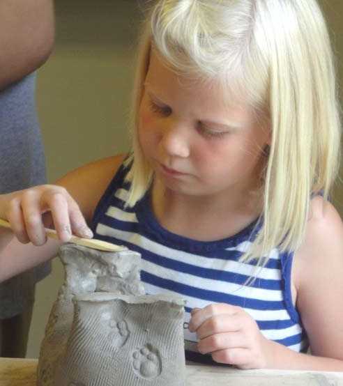 child-hard-at-work-pottery- (2).jpg