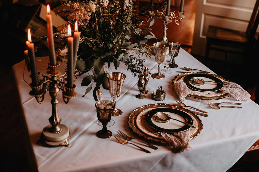 moody tablescape green wedding shoes