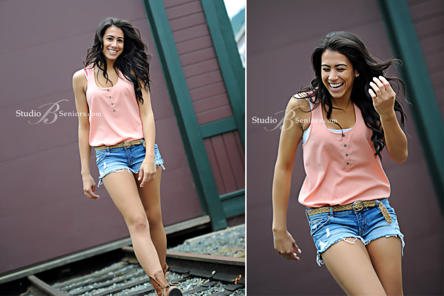Beautiful-teenage-girl-walking-down-the-railroad-tracks-laughing-in-Issaquah