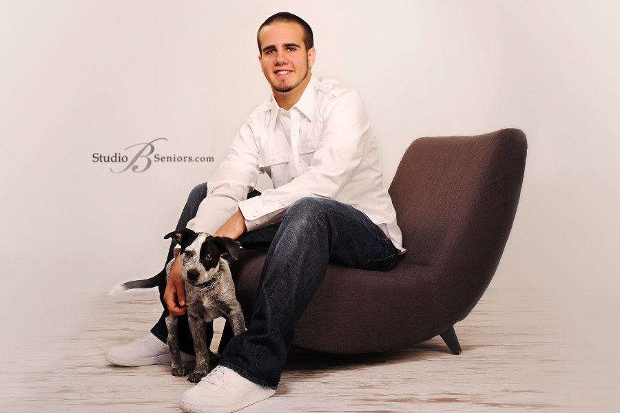Best-Senior-Pictures-in-Seattle-of-boy-from-Mount-Si-High-School-with-his-puppy-dog-at-Studio-B-in-Issaquah