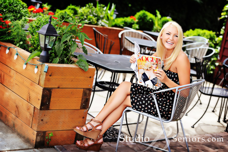 Senior-Pictures-of-Skyline-High-School-pretty-blonde-outdoors-reading-Vogue-Magazine