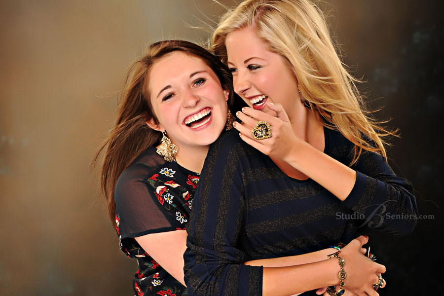 Best friends-laughing-during-high-school-senior-pictures-photo-shoot-at-Studio-B-in-Issaquah