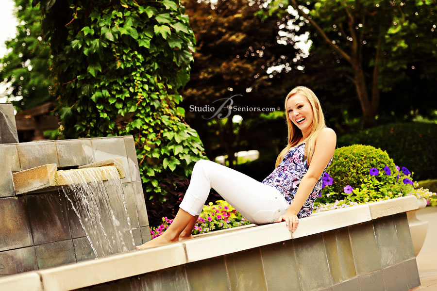 Pretty-girl-senior-pictures-of-Sammamish-teen-playing-in-Hotel-Bellevue-fountain-photographed-by-Studio-B