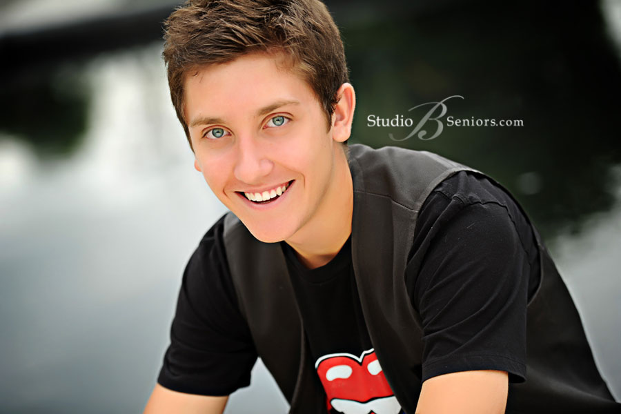 Smiling-boy-senior-pictures-by-the-water-outdoors-in-Issaquah-near-Bellevue