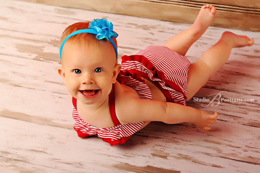 Best-baby-portraits-in-Issaquah-near-Bellevue-of-7-month-old-girl-in-swimsut-laughing