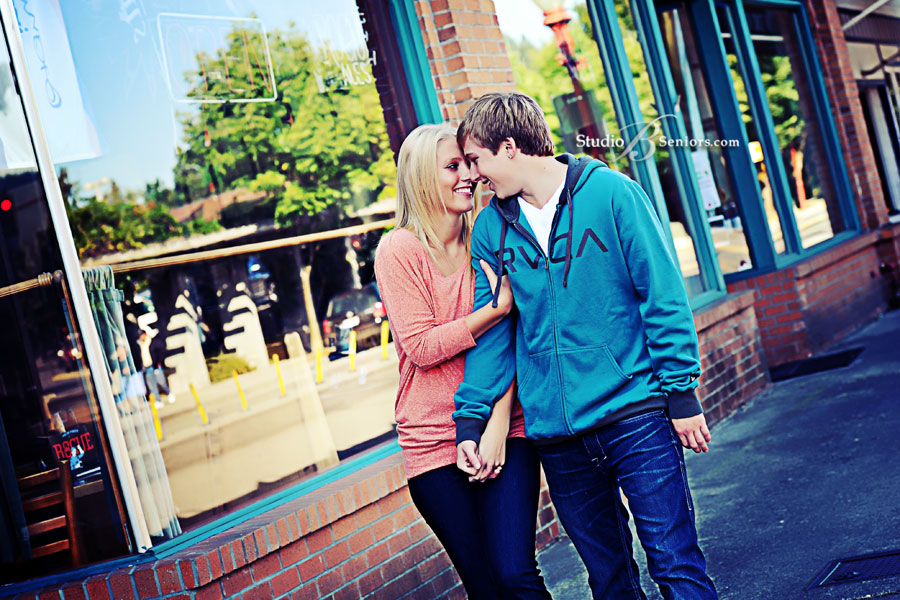 Cute-high-school-senior-pictures-of-boy-and-girl-couple-holding-hands-in-downtown-Issaquah