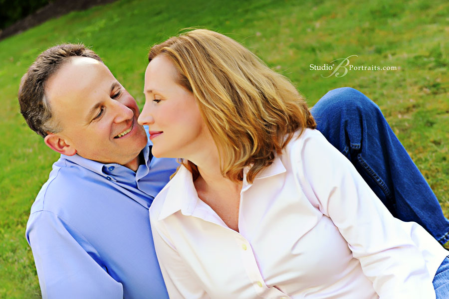 Married-couple-having-a-sweet-moment-during-family-pictures-in-Bellevue