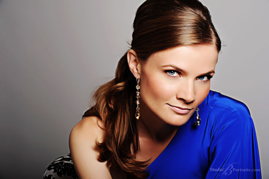 Professional-headshot-of-woman-in-blue-cocktail-dress