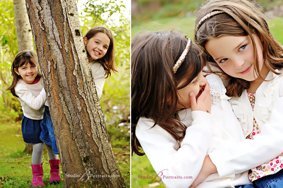 Cute-little-sisters-laughing-during-family-picturesin-Issaquah-at-Studio-B-Portraits