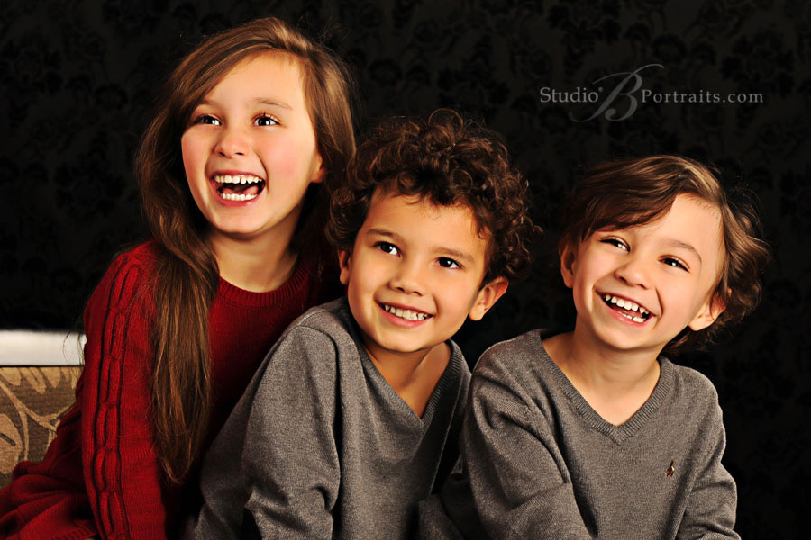 Beautiful-children-laughing-during-their-holiday-photo-shoot-in-Issaquah-WA-portrait-studio
