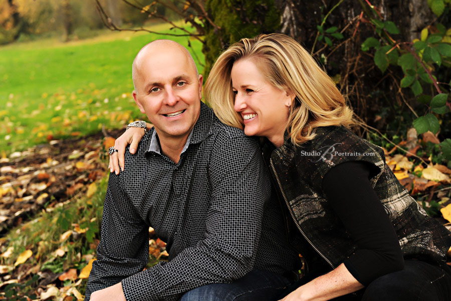Man-and-woman-smiling-during-outdoor-family-photo-shoot