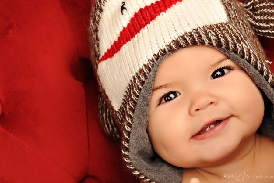 Baby-in-a-monkey-hat-at-Studio-B-Portraits