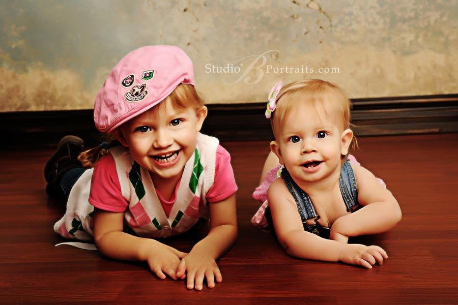 Smiling-sisters-at-Studio-B-Portraits-photo-shoot