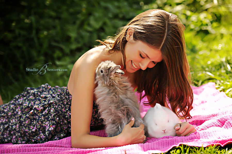 Eastsdie-Cathollic-High-School-Senior-pictures-of-girl-laughing-with-rabbits-by-Studio-B