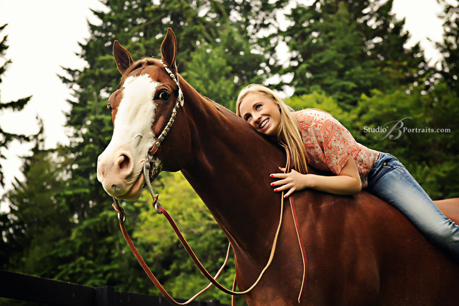 High-school-senior-pictures-of-girl-smiling-on-her-horse-near-Redmond-by-Studio-B-Portraits