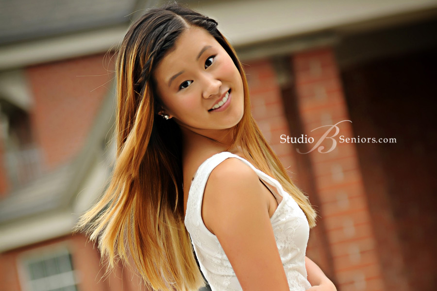 Issaquah-High-School-senior-pictures-of-pretty-Chinese-girl-in-front-of-brick-building