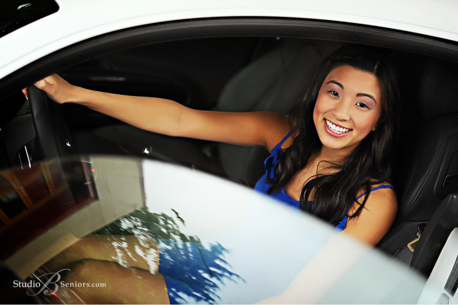 Pretty-Asian-High-School-Senior-in-car-for-senior-pictures