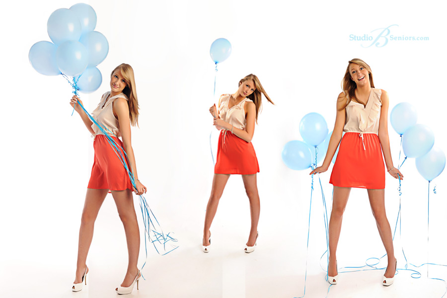 Pretty-high-school-senior-girl-with-blue-balloons-in-orange-color-block-dress-at-Studio-B-near-Seattle