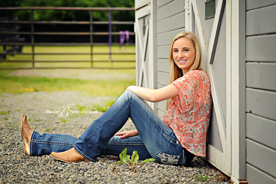 Senior-pictures-near-Sammamish-of-Eastside-Catholic-High-School-girl-at-barn