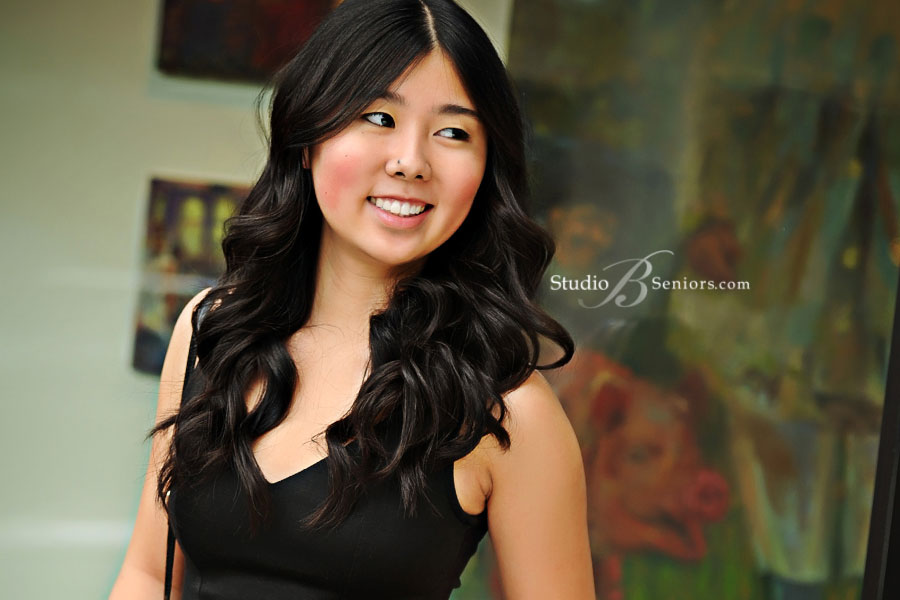 Skyline-senior-pictures-of-pretty-asian-girl-in-black-dress-shopping