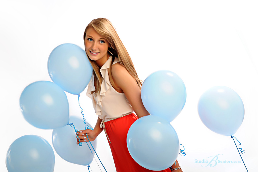 Smiling-High-school-senior-with-ballons_at Studio B Portraits
