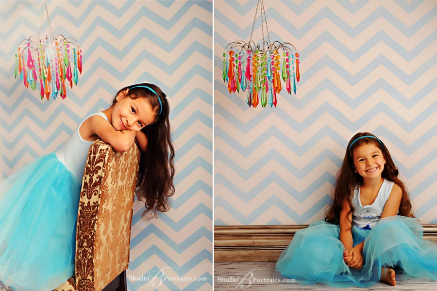 Best-childrens-photograph-in-Seattle-featuring-pretty-girl-in-blue-dress-on-chevron-background-with-chandelier