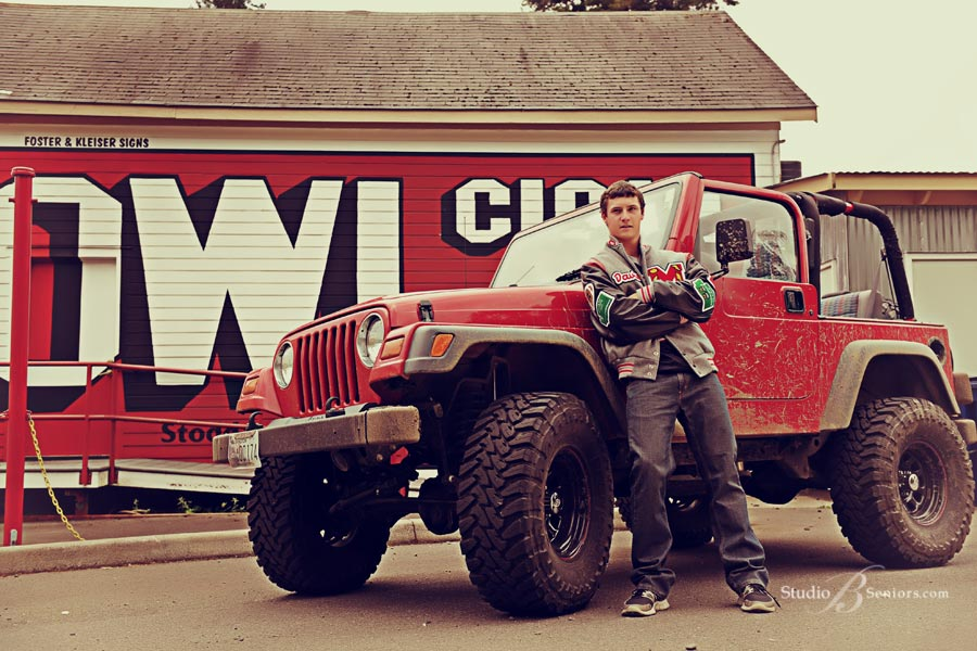 Cool-boy-senior-pictures-of-football-player-with-his-jeep-at-Studio-B-Portraits