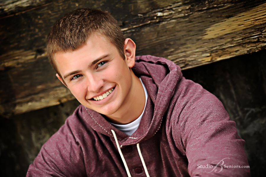 Outdoor-high-school-senior-pictures-of-smiling-guy-in-Issaquah-near-Sammamish-WA