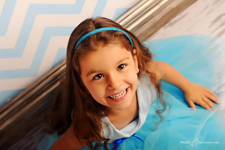 Professional-childrens-portrait-of-girl-in-blue-tutu-on-chevron-background