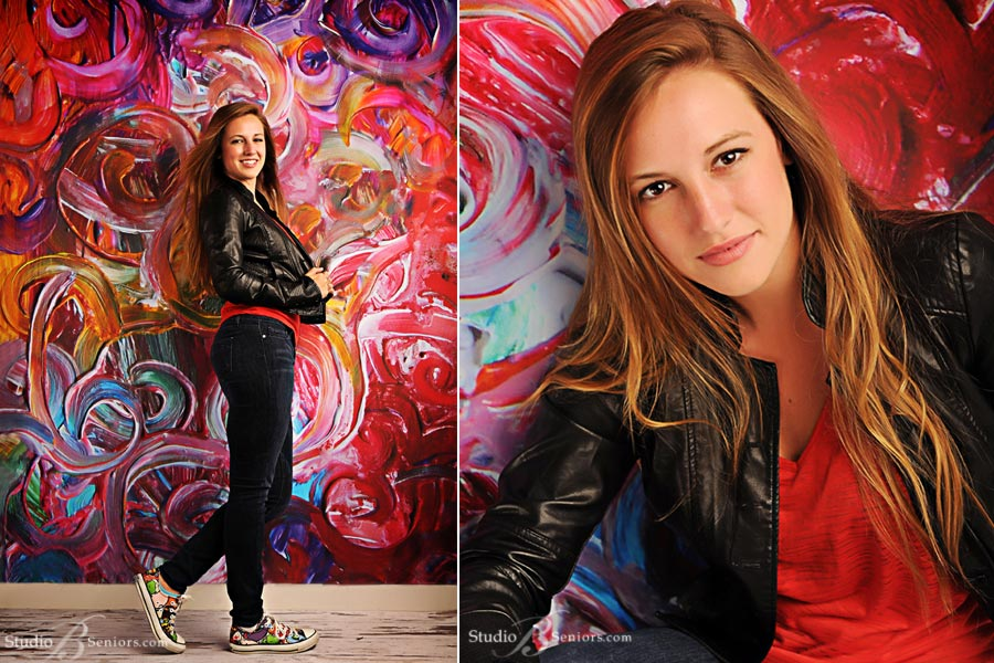 Skyline-High-School-senior-pictures-of-pretty-girl-on-hand-painted-colorful-wall-at-Studio-B-in-Issaquah