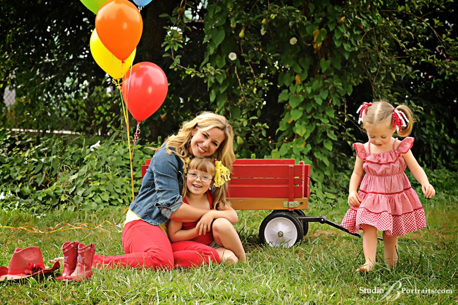 Summer-family-pictures-of-gorgeous-girls-in-field-with-gingham-and-red-wagon