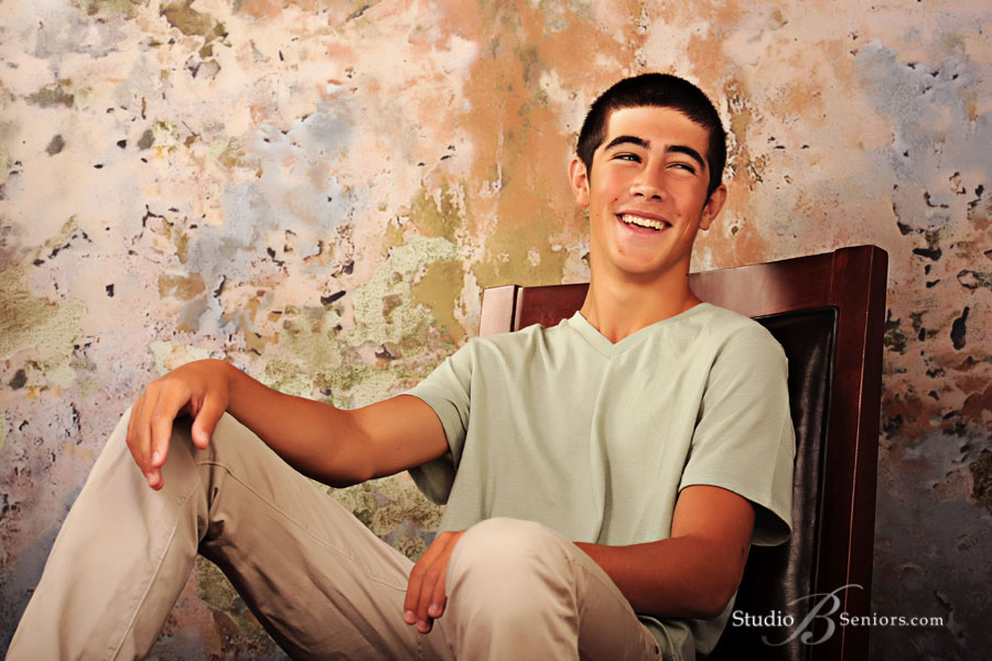 Boy-senior-pictures-of-Argentinian-guy-laughing-from-Skyline-High-School-at-Studio-B-in-Issaquah