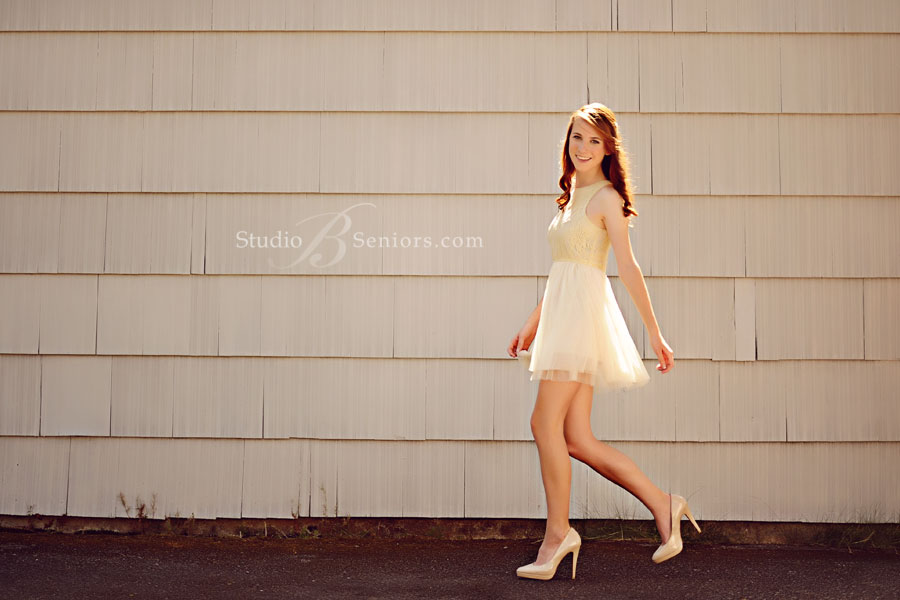 Fashion-senior-pictures-that-look-like-Seventeen-Magazine-of-girl-walking-in-prop-dress