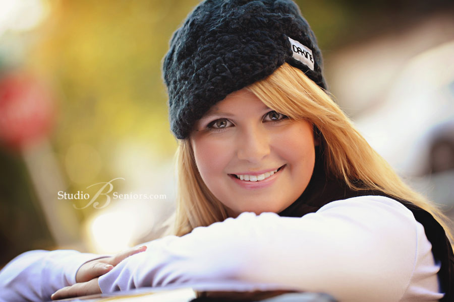 Pretty-blond-high-school-senior-photographed-in-a-snow-hat-at-Studio-B-Portraits-in-Issaquah