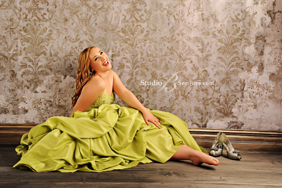 Fashion-senior-pictures-in-green-prom-dress-laughing-at-Studio-B-Portraits